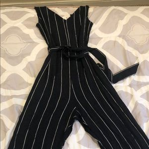 navy and white jump suit
